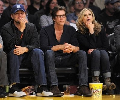 Actors Leonardo DiCaprio, left, Kevin Bacon and Kyra Sedgwick watch the Los ...