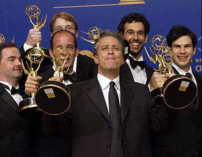 Jon Stewart, front center, stands with writers from his show as they pose with the awards they won for outstanding writing for a variety, music or comedy series for The Daily Show with Jon Stewart at the 55th Annual Primetime Emmy Awards Sunday, Sept. 21, 2003, at the Shrine Auditorium in Los Angeles. Stewart also won for outstanding variety, music or comedy series. Photo by Reed Saxon