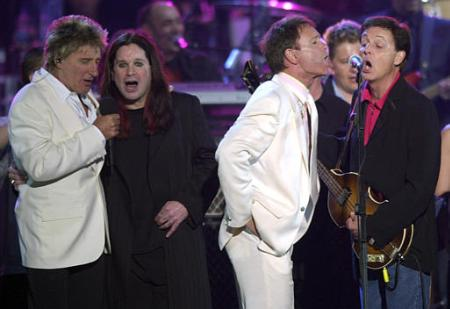 Rod Stewart, from left, Ozzy Osborne, Sir Cliff Richard and Sir Paul McCartney sing on stage during the finale in the gardens of Buckingham Palace Monday June 3, 2002, after the second concert to commemorate the Golden Jubilee of Britain's Queen Elizabeth. PHOTO by Stefan Rousseau