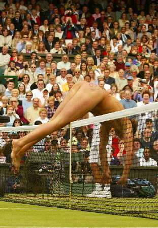 A streaker dives over the net during the men's singles final between Argentina's David Nalbandian and Australia's Lleyton Hewitt at the Wimbledon tennis championships, July 7, 2002. Photo by Ian Hodgson